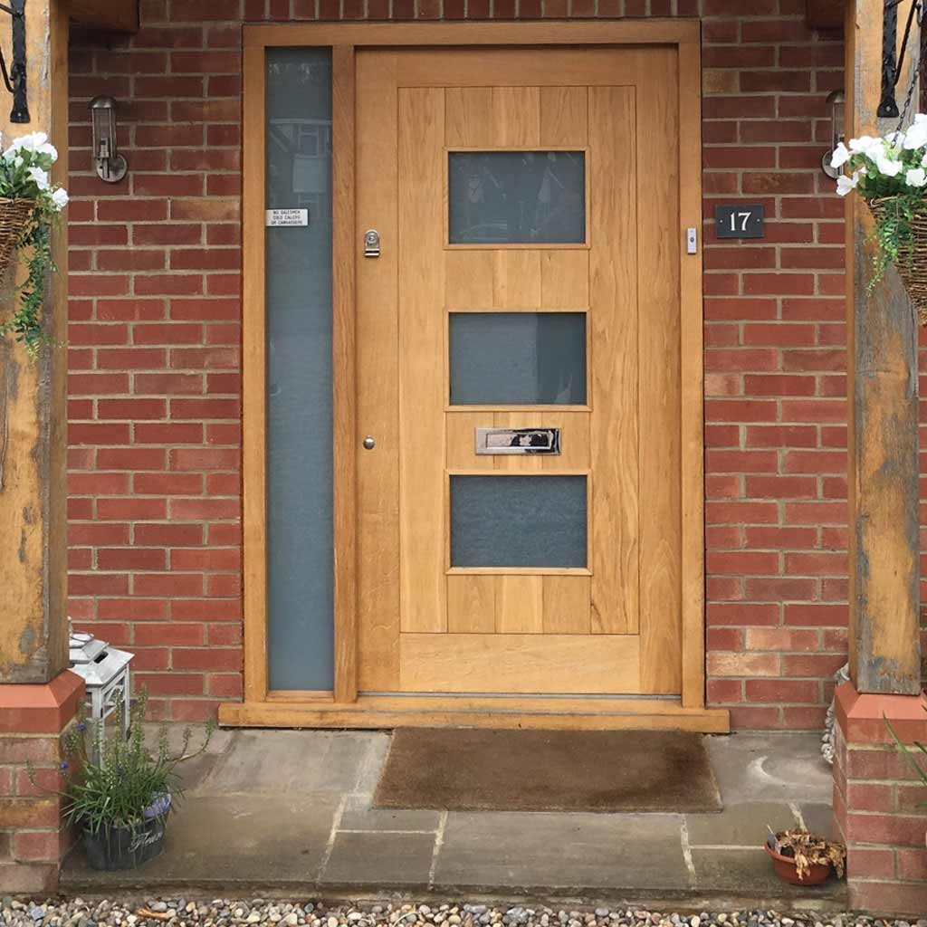 large photo of a wooden door crafted by Henley Joinery